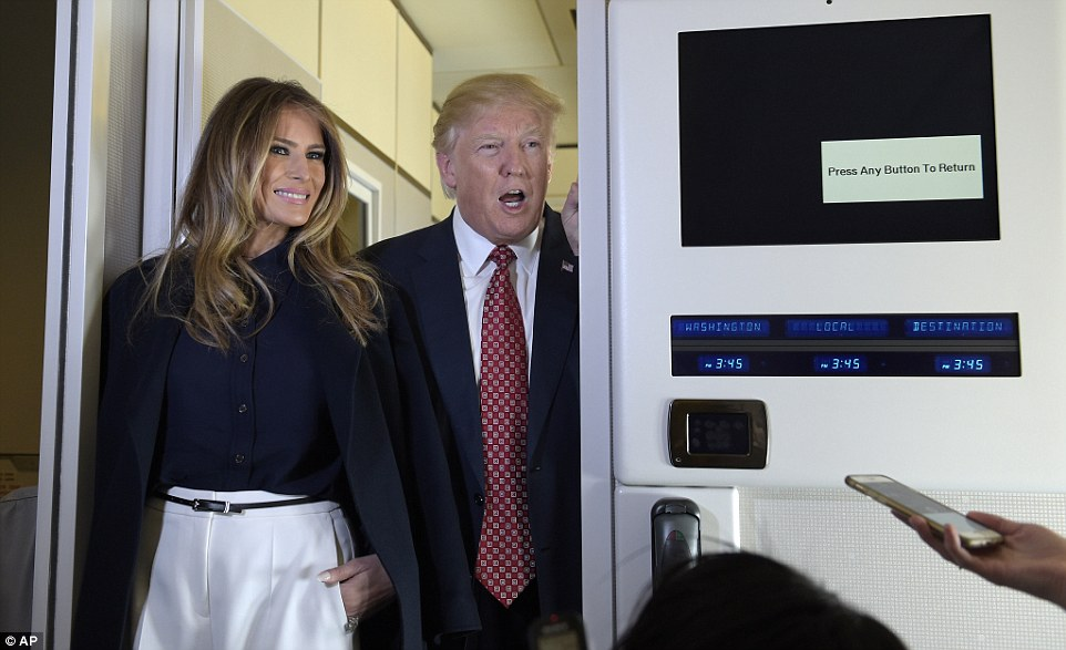 In flight entertainment: Melania and Donald Trump went to the press cabin of Air Force One en route to Palm Beach
