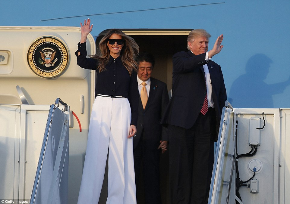 Arriving: Air Force One touched down at Palm Beach International at sunset and the first couple emerged before their Japanese guests