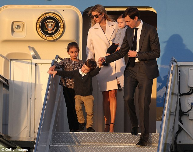 Trump and Kushner walk off Air Force One with their children at Palm Beach International airport as they prepare to spend part of the weekend together with her father President Trump at Mar-a-Lago resort