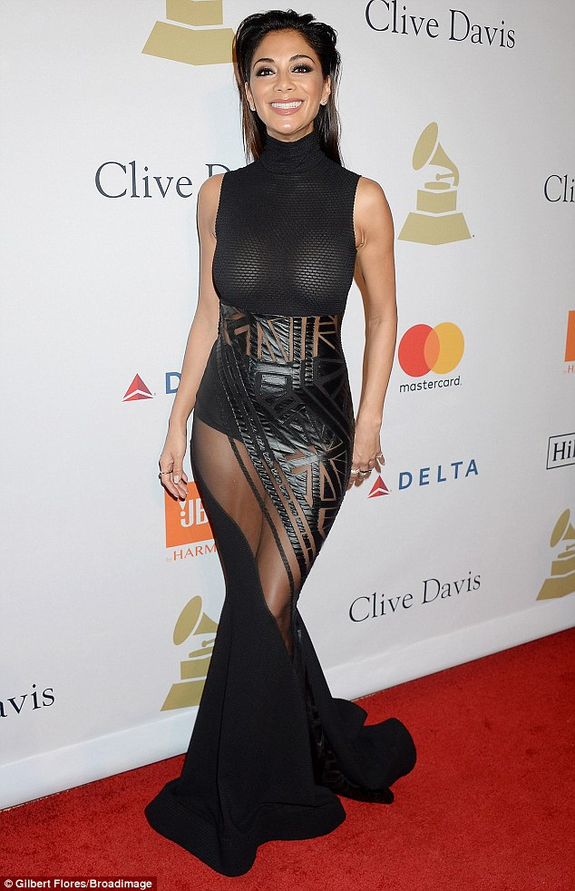 Jeepers!Nicole Scherzinger did more than that as she turned heads at Clive Davis' annual Pre-Grammy party in Beverly Hills on Saturday