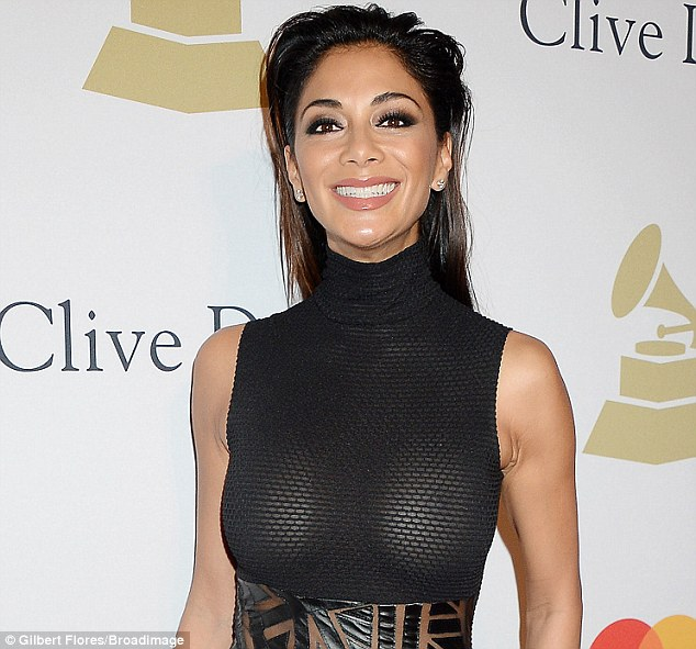 Confident:The 38-year-old certainly put on an eye-popping display as she wore a sheer dress with no bra to the event