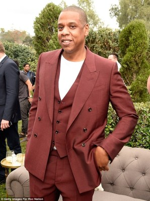 Living it up: Jay Z, 47, was in high spirits at the Roc Nation pre-Grammy brunch in LA on Saturday, in light of the news he is expecting twins with his wife Beyonce