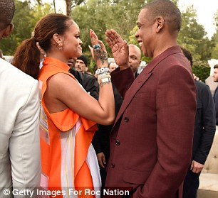 Keeping it cool: The pair, who have collaborated numerous times, were seen laughing animatedly together before exchanging a high-five as they bid each other farewell