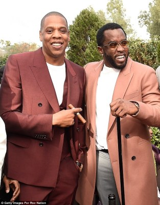 Chilling out:Satisfying their hunger for the day, Jay and Diddy, who was born Sean Combs, then switched to the harder stuff as the party got into full swing