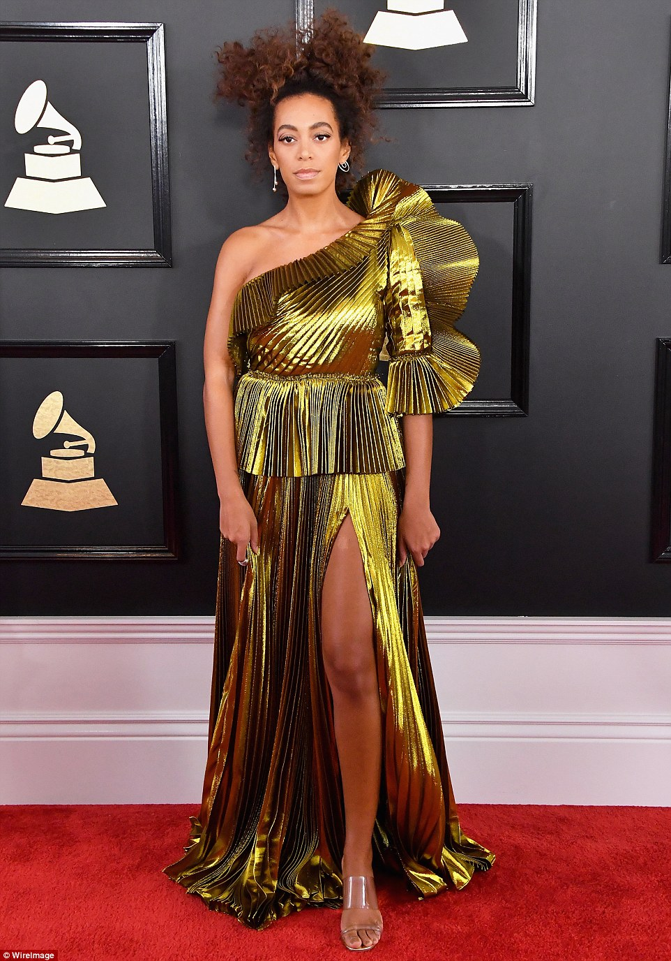Precious metal: Solange Knowles arrived in a gold crinkled gown with leg slit