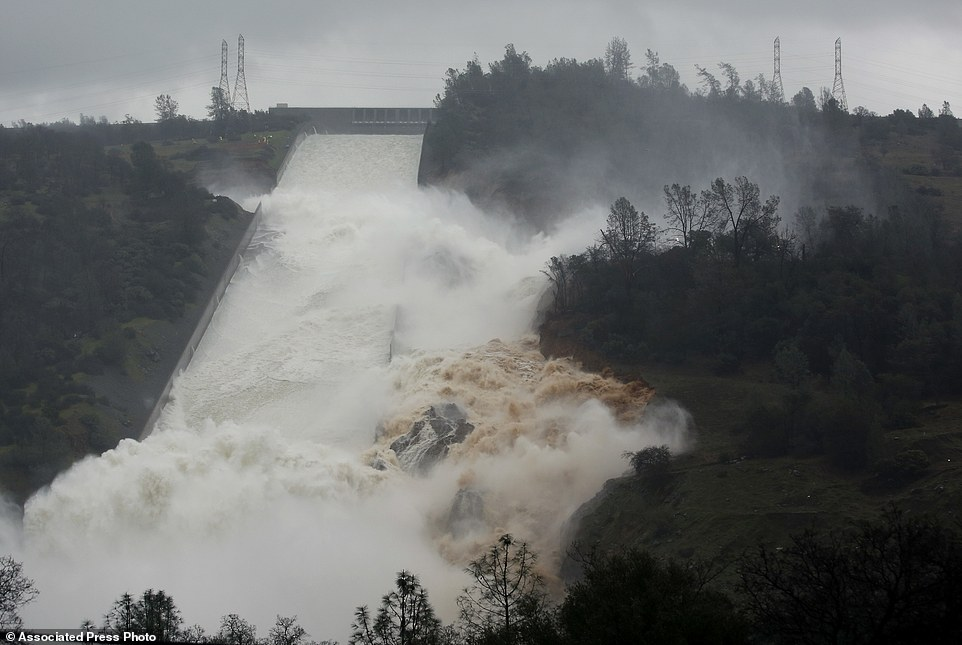 Officials say water falling over the Oroville Dam's emergency spillway has stopped as Oroville lake levels dropped low enough