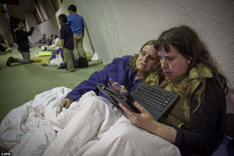 Breaking news: Colette Roberts and her daughter Lesilee watch video updating the of the Oroville dam evacuations