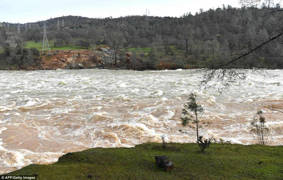 Makeshift: Water rushes down a spillway as an emergency measure at the Oroville Dam in Oroville, California