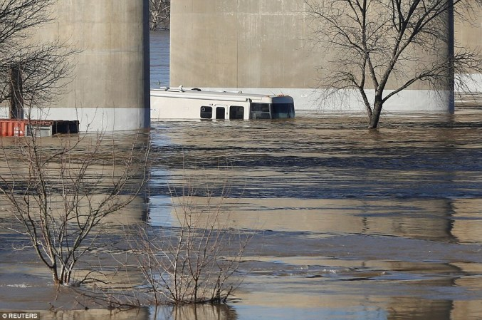 Swamped: The town of Marysville, 50ft away from the dam, was submerged on Tuesday as rivers continued to swell
