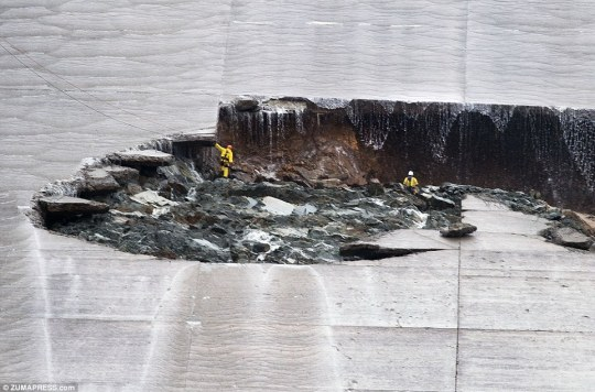 Water flow on the main spillway was halted last week as agencies investigated a huge hole which had formed (above)