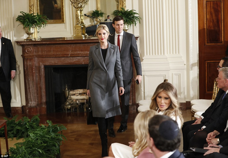Business buddies: Ivanka and her husband Jared Kushner attended the early afternoon press conference as well, entering while Melania was in conversation (above)