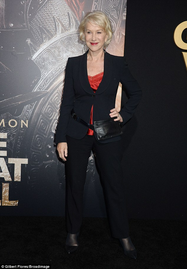 Stylish: The structured black suit was held in place with one button and teased snippets of her sexy vest top underneath. She teamed the look with a bum-bag Read more: http://www.dailymail.co.uk/tvshowbiz/article-4230026/Helen-Mirren-oozes-sophistication-power-suit.html#ixzz4YsfQ5C9l Follow us: @MailOnline on Twitter | DailyMail on Facebook
