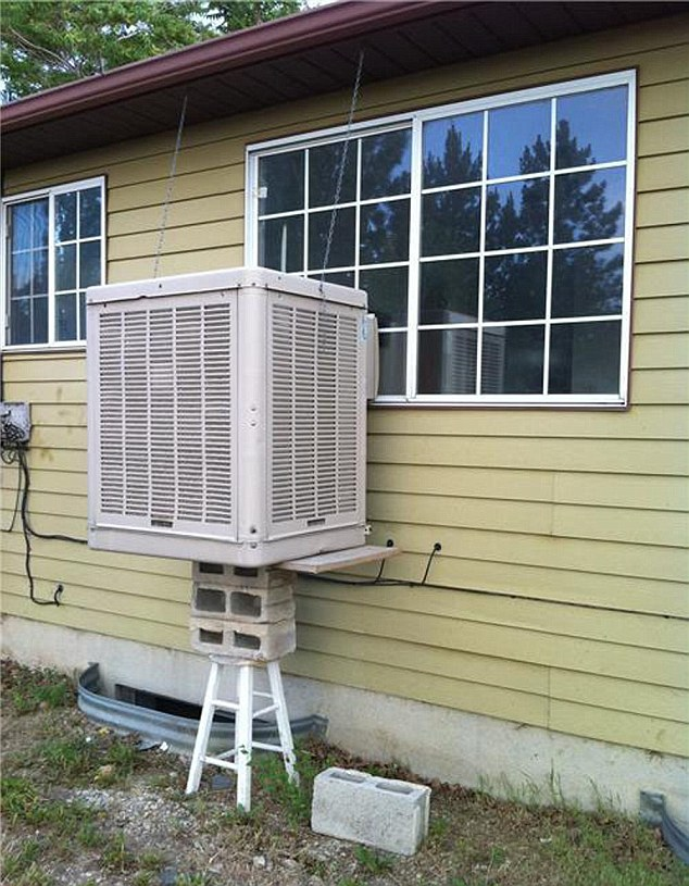 This dangerously propped up air conditioning unit looks as if it could buckle the stool at any moment