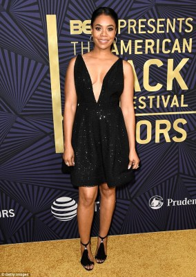 Youthful! Host Regina Hall, 46, absolutely sparkled in her plunging little black dress, which she paired with some adorable tassel-bearing black pumps
