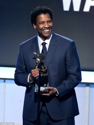 All smiles: Denzel Washington, 62, was also on hand to receive an award