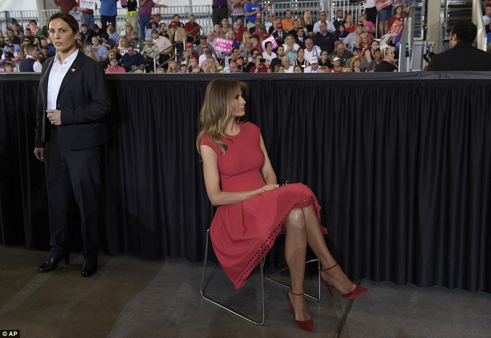 First lady Melania Trump sits and listens to President Donald Trump speak at the campaign-style rally