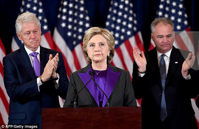 Podesta said it was 'inexplicable' that the FBI didn't send agents to the Democratic National Committee to investigate the hack of its emails. Above, Clinton is pictured giving her concession speech weeks later