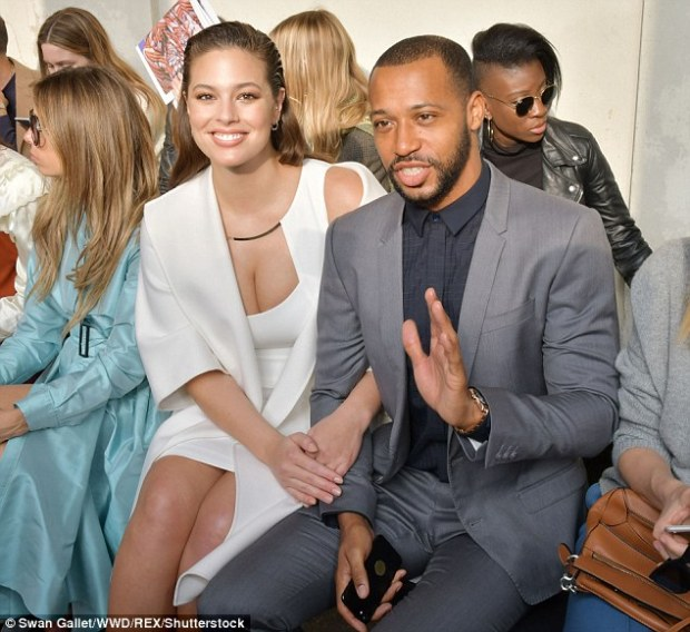 Arm-in-arm: Ashley linked arms with her handsome husband as they sat in their FROW seats