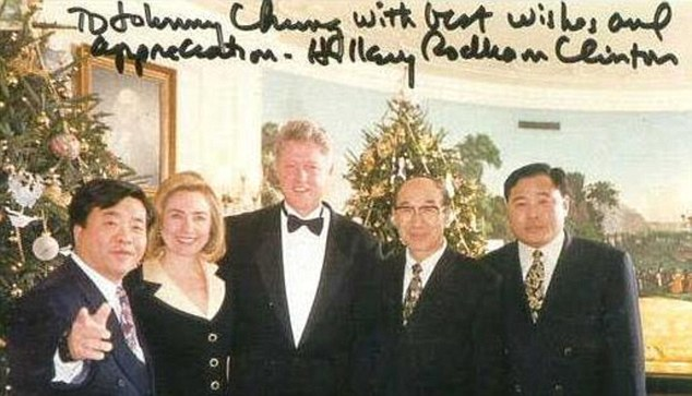 Trusted: Johnny Chung's fundraising made him someone the Clinton were keen to be seen with - and to thanks. But when the businessman (left) got caught up in scandal, he feared for his life. Quite how close they were is shown in this picture - signed by Hillary Clinton