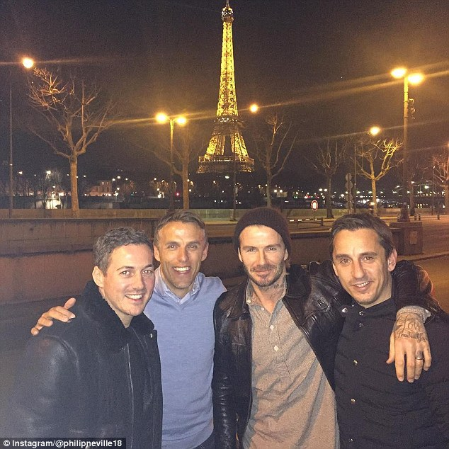 Boys are back in town! The 41-year-old appeared to be in great spirits as he posed with Phil and Gary Neville and his old friend Dave Gardner, who is Liv Tyler's fiance, in front of the Eiffel tower