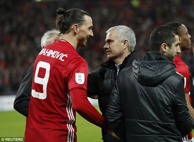 Zlatan Ibrahimovic celebrates at the end of the EFL Cup final with Jose Mourinho