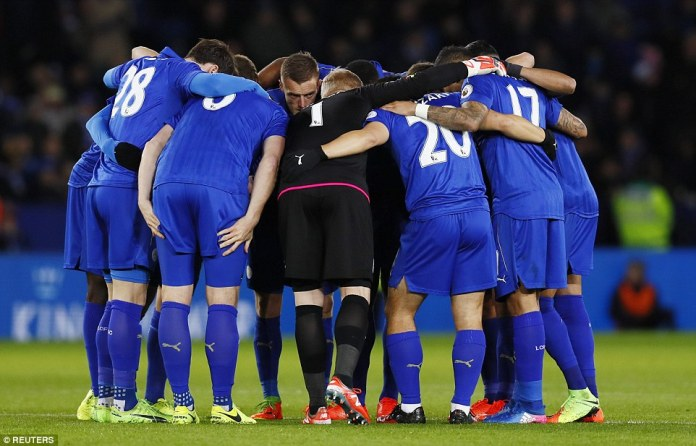 The under-fire Leicester City players huddle up for a team talk ahead of kick-off against Jurgen Klopp's Liverpool side