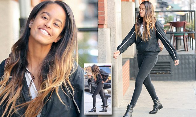 Malia Obama smiles as she heads to NYC internship