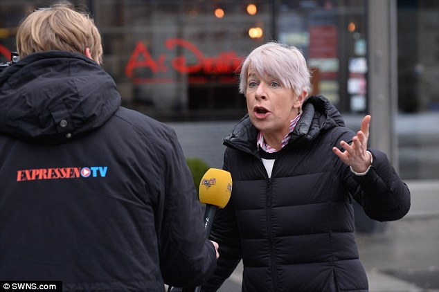 A national news outlet in Sweden interviews Katie outside the Kista police station