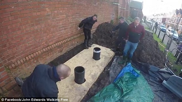 John Edwards has been buried alive to raise awareness of drug addiction and depression
