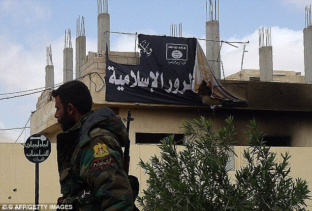 An ISIS flag flies in the city of Palmyra - but not for long as victory nears in the city