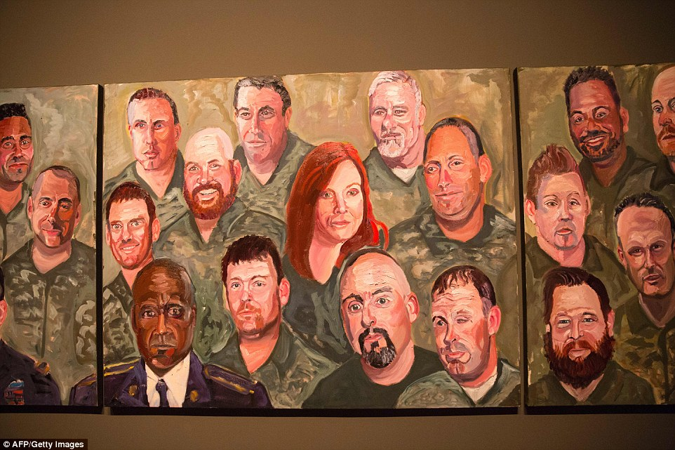 Paintings of wounded US military veterans painted by former US President George W. Bush hang in 'Portraits of Courage', a new exhibit at the George W. Bush Presidential Library and Museum in Dallas