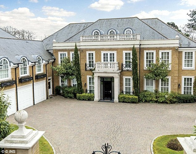 Friends fear that burglars may have been encouraged to raid the mansion in Oxshott after seeing pictures of it on the couple's Instagram pages