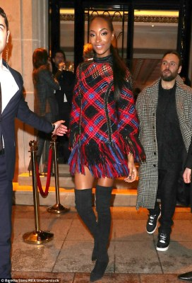Catwalk star: The beautiful mother-of-one donned an intriguing woven minidress which featured a plaid-like pattern of pink, red, blue and black