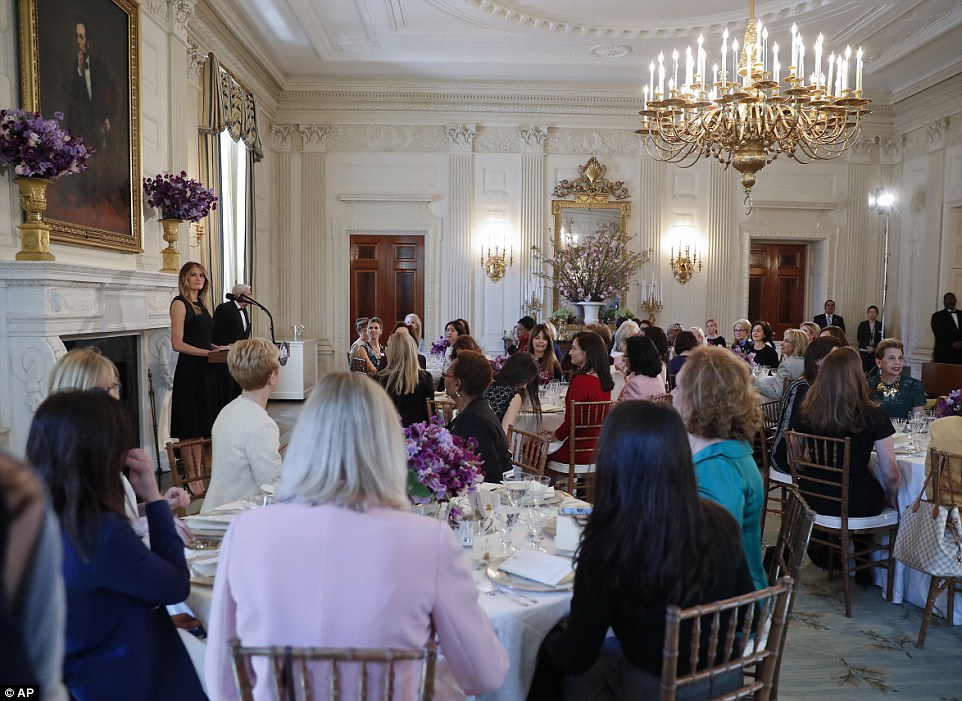 The crowd listens to Melania Trump speak in the State Dining Room today at the White House in honor of International Women's Day