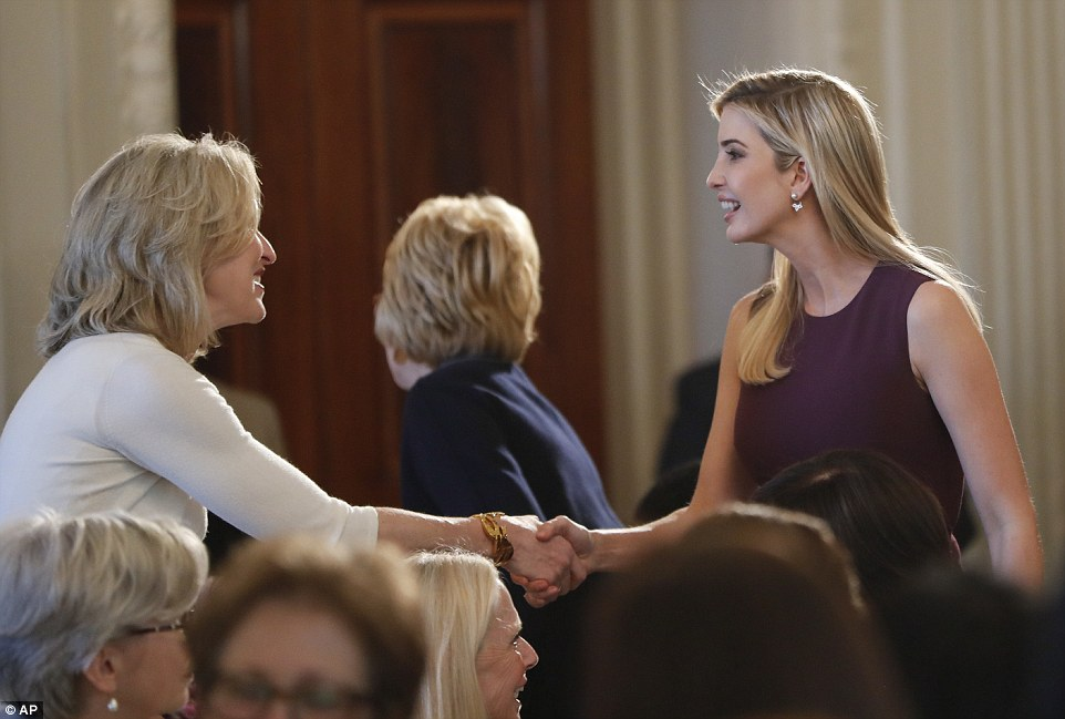 First daughter Ivnaka Trump (right) greets a guest at the first lunch put on by first lady Melania Trump