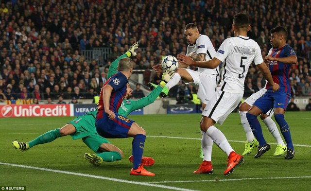 Layvin Kurzawa somehow guides the ball into the back of his net as he attempts to hook it clear inside his own six-yard box
