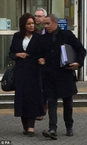 Paula Vasco-Knight (left) pictured leaving the court with her husband and brother (centre, right) during the two-week trial held in Exeter