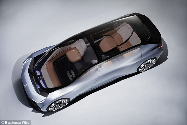 The new design is more like a living room on wheels than a car, with a fold out table and reclining seats