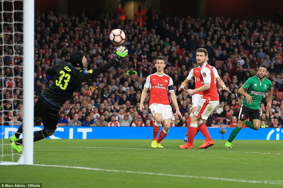 Lincoln very nearly took the lead as Petr Cech thwartedNathan Arnold shot after he showed excellent footwork