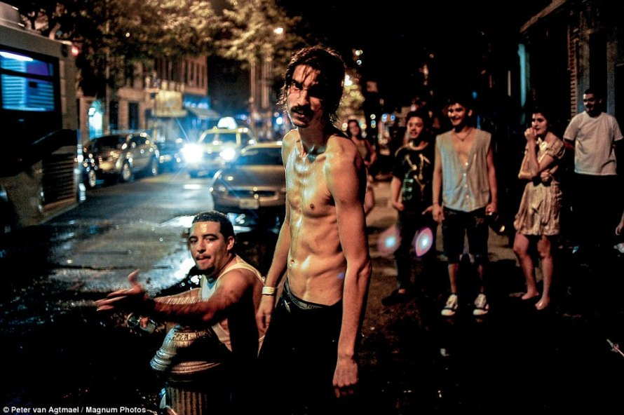 The esteemed photographer wanted to honestly highlight the economic inequity and racism that still grips parts of America. Above people stand on a busy street in Brooklyn, New York in 2010