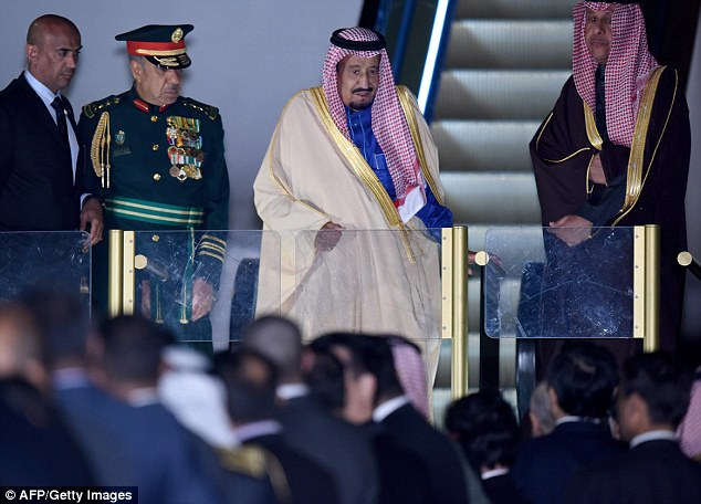 Saudi Arabian King Salman (centre) gets off the plane upon his arrival at Haheda Airport in Tokyo on March 12, 2017