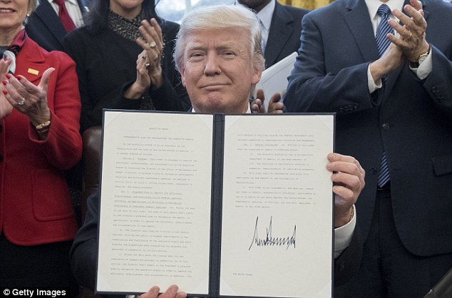 The president signed a mandate Monday requiring federal agencies to identify wasteful and inefficient programs as part of a reorganization of the executive branch that he says will be 'very, very special'