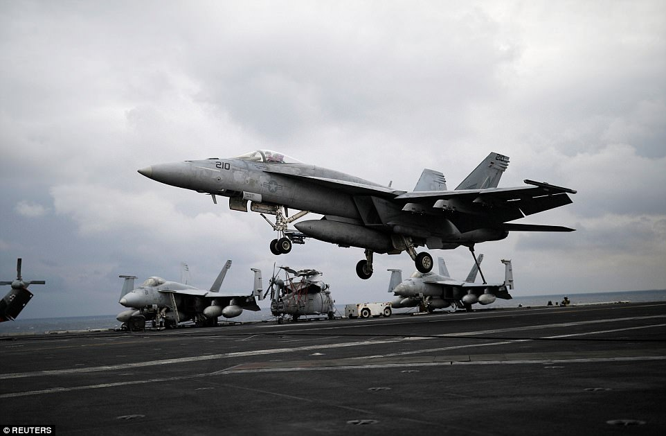 A U.S. F18 fighter jet lands on the deck of U.S. aircraft carrier USS Carl Vinson during the annual joint military exercise