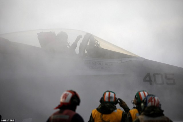 A F18 fighter jet prepares for take off as part of the annual military drills in South Korea  that the North  regards as rehearsal for invasion
