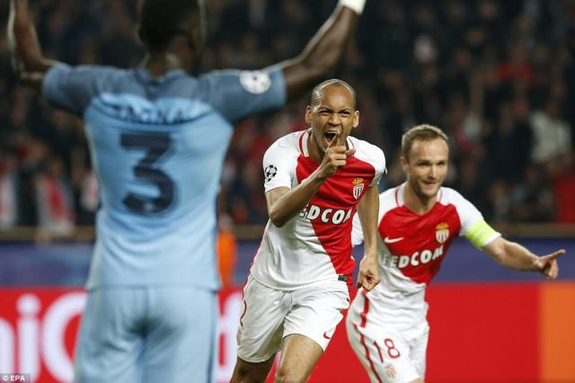 Brazilian international Fabinho wheels away in celebration after giving his side a two-goal advantage on the night