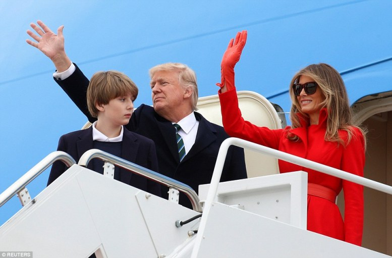 Waving: The first family waved to onlookers - not something the President always does when he boards