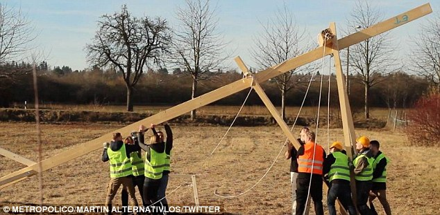 Right-wing activists from the Citizens for Erfurt group erect the cross at the site