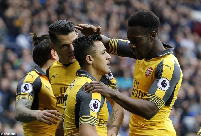 Danny Welbeck and Xhaka congratulate their Arsenal team-mate Sanchez after he scores the equalising goal