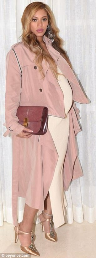 Standout piece: Beyonce threw on a statement pink coat adorned with buttons and trim