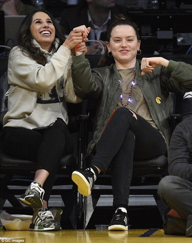 Having a blast: The British actress, 24, ensured to get into the spirit of things by putting on a high energy display as she took to the front row with a pal